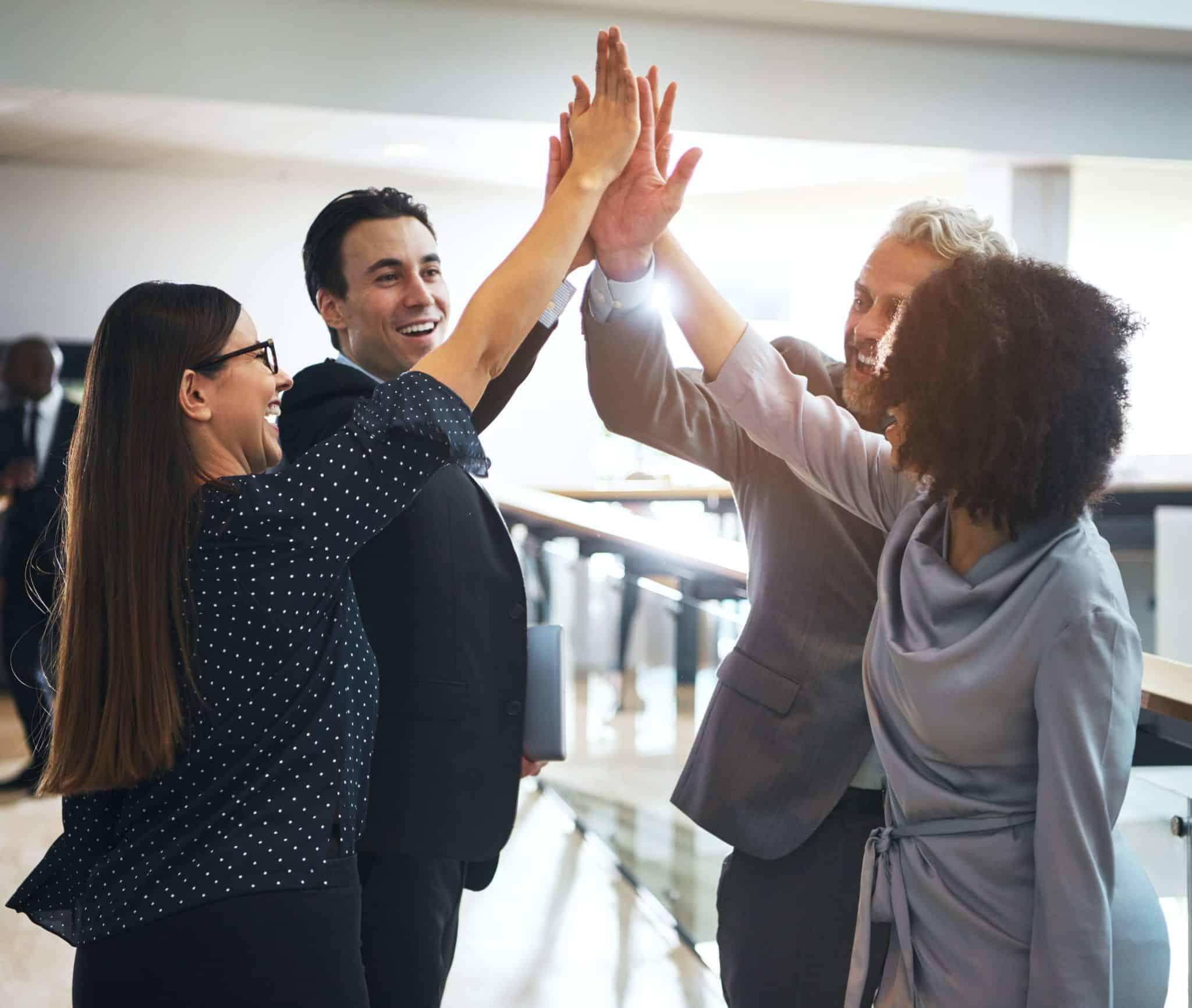 office team giving high five